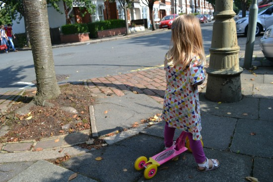 Toddler on scooter in Tootsa Macginty dress