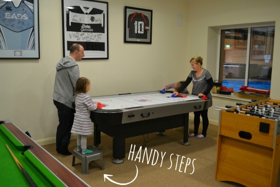 Playing air hockey at Clydey
